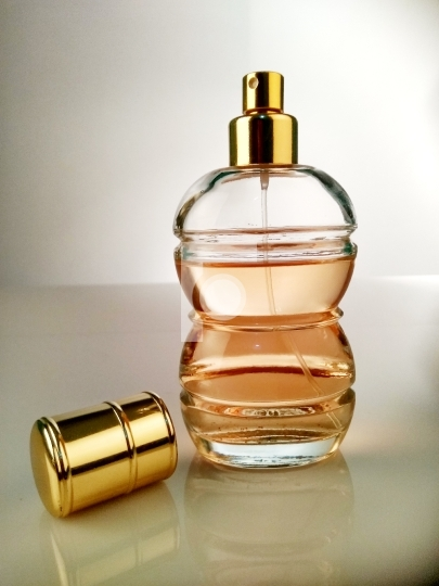 Beautiful Perfume Bottle On White Reflective Surface Free Stock