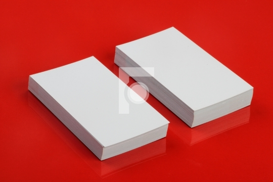 Blank White Business Card for Mockup on Red