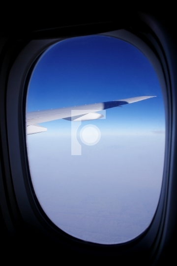 blue sky and aeroplane window - vacation concept