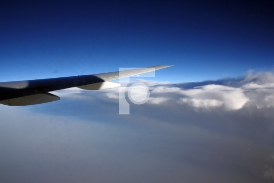 blue sky and aeroplane wing - vacation concept