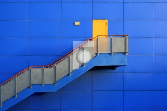 blue wall and yellow door on top