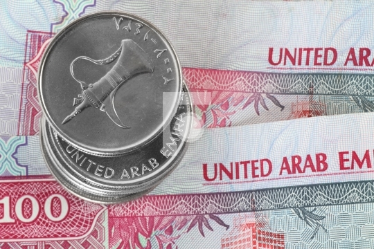 Closeup of dirham coins on notes