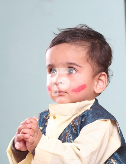 Cute Indian Baby Boy Celebrating Holi with Colour on Face