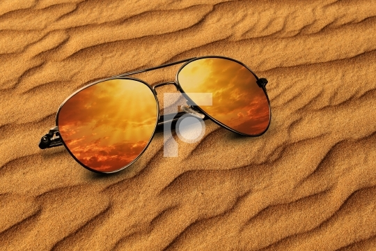 Desert sand and Sunglasses Reflection Vacation Concept