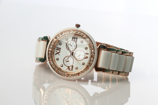 Diamond Studded Wrist Watch On White Background