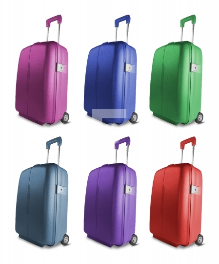 Different colored suitcases isolated on white background