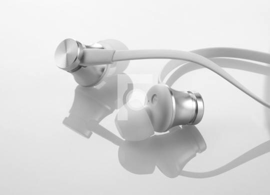 Earphones Headphones on Reflective White Background