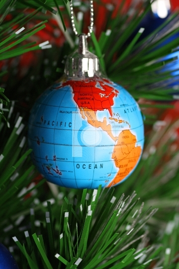 Globe as onament on christmas tree, christmas concept
