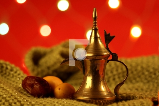 golden arabic tea pot with dates