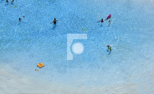 group of people swimming on the beach
