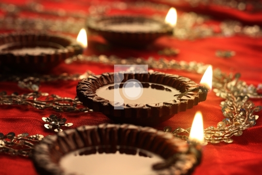 Indian Diwali Diya with Festive Lights and Bokeh