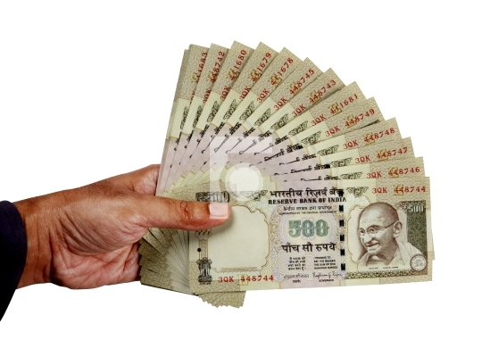 Indian Money 500 Rupees Currency Notes in a Hand