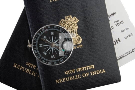 Indian passports, magnetic compass, boarding pass