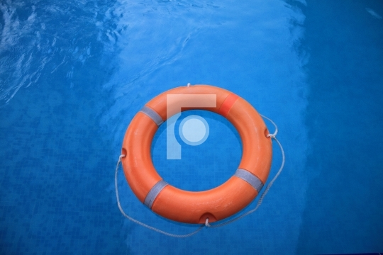 Lifebuoy in Blue Water - Safety Measures Free photo