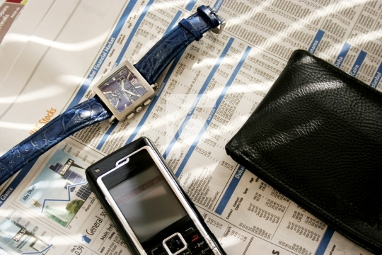 mobile, wallet and wrist watch