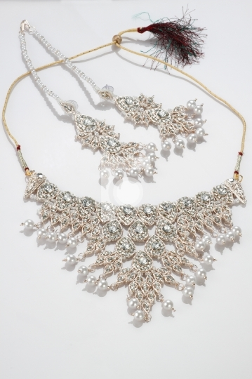 Modern Intricate Indian Jewelry Diamond Necklace Set on White Ba