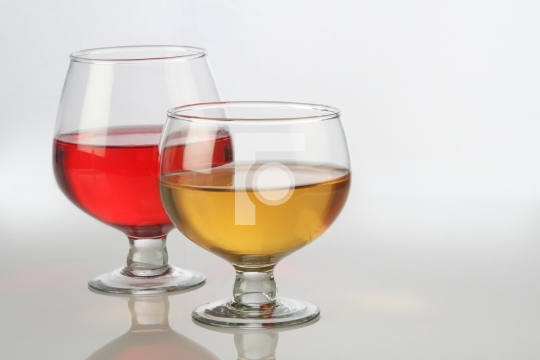Red and White Wine Glasses with Reflection on White