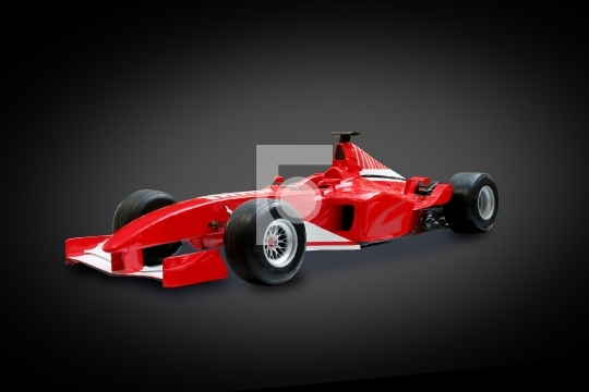 Red Formula One Car in black background