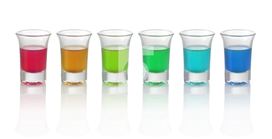 Six different color drinks in glasses on white background