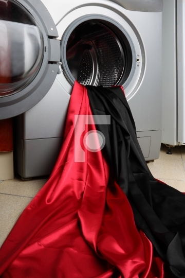 Smooth red and black satin fabric in a washing machine