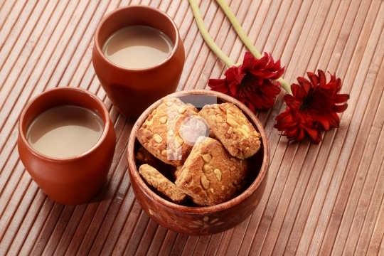 Tea in Handmade Indian Pottery Glass Mug with Biscuits