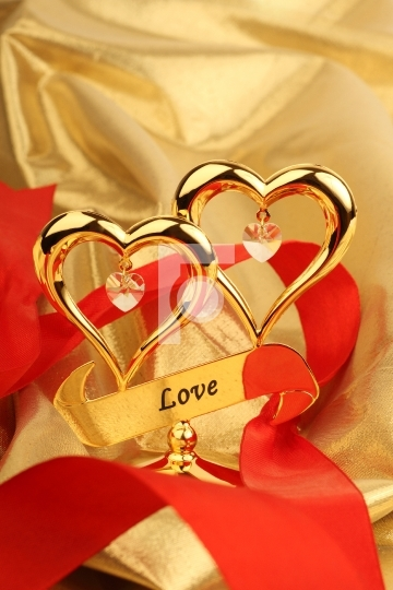 Two Golden heart on a gold color fabric