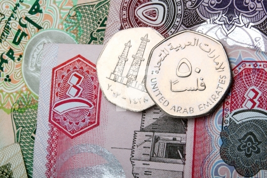 uae currency dirhams - 50 fils coins and dirham notes