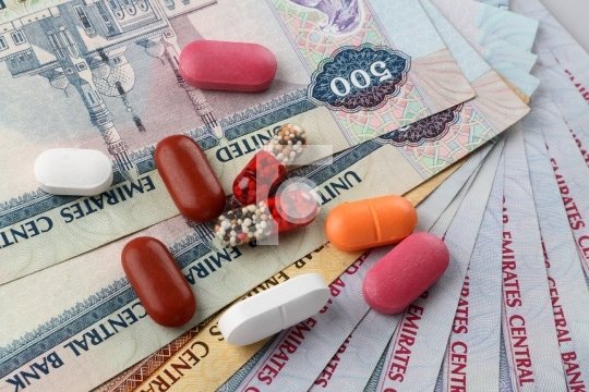 UAE Currency Dirhams and Medicine Pills