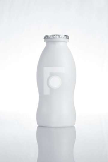 White Plastic Milk Bottle on White Background with Reflection