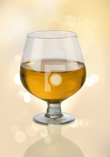 White Wine Glass with Blurred Lights Bokeh Background
