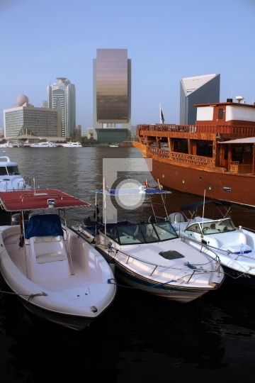 Yacht in front of dubai creek buildings